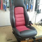 Leather upholstery on bucket seat