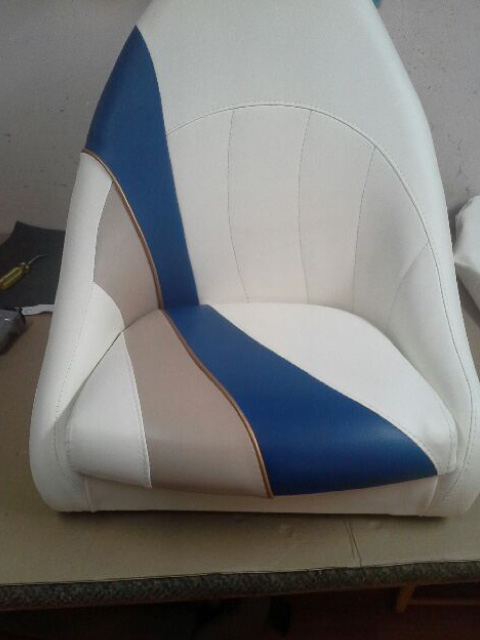 Boat seat with geometric leather design