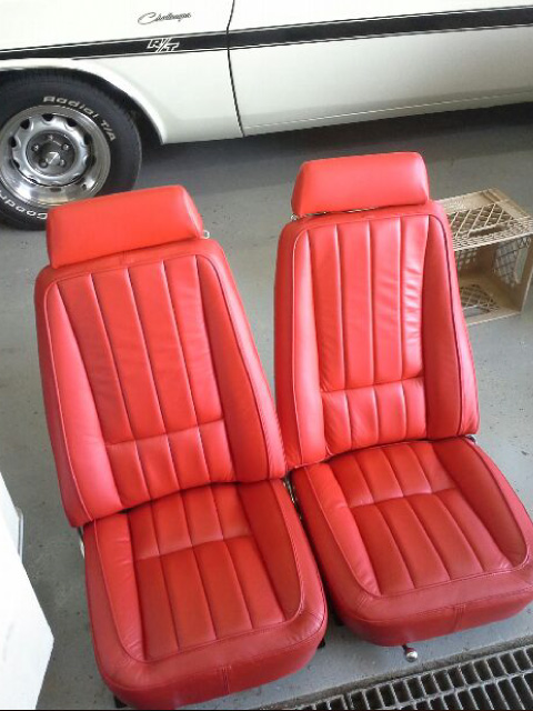 Red leather bucket seats